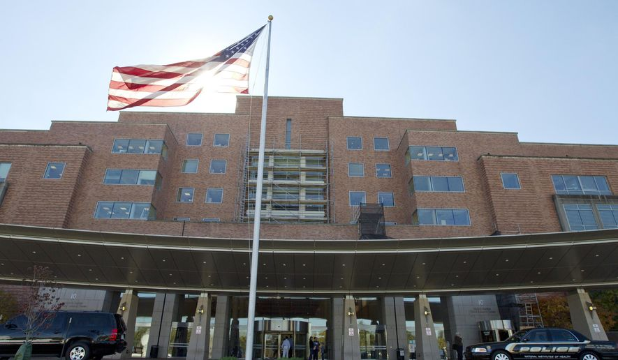 FILE - In this Oct. 17, 2014 file photo, The National Institutes of Health Mark O. Hatfield Clinical Research Center.  (AP Photo/Jose Luis Magana, File)