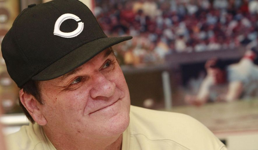 """FILE - In this July 26, 2011, file photo, former Cincinnati Reds player Pete Rose signs autographs at the Collectors Den in at a mall in Indianapolis. Rose has submitted a new request to be reinstated to baseball, according to new Commissioner Rob Manfred. After meeting with the Los Angeles Dodgers on Monday, March 16, 2015, Manfred said """"I do have a formal request from Pete.  (AP Photo/The Indianapolis Star, Charlie Nye, File)  NO SALES"""