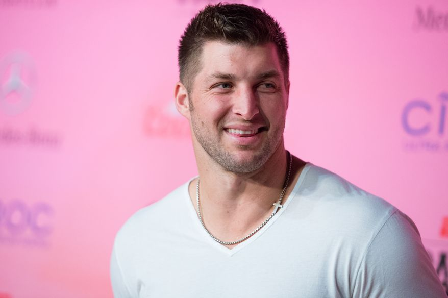Tim Tebow arrives at the ESPN Super Bowl XLIX Party on Friday, Jan. 30, 2015 in Scottsdale, Ariz. (Photo by Scott Roth/Invision/AP)