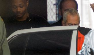 "Robert Durst is escorted from Orleans Parish Criminal District Court, Monday, March 16, 2015, in New Orleans. Durst, a millionaire from one of America's wealthiest families, agreed Monday to return to Los Angeles to face a 15-year-old murder charge after muttering that he ""killed them all"" in a documentary about his links to three sensational killings. (AP Photo/Matthew Hinton)"