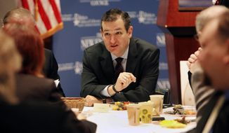 Ted Cruz, R-Texas speaks with area business leaders during a Politics and Eggs breakfast, Monday, March 16, 2015, in Manchester, N.H. (AP Photo/Jim Cole)