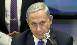 Israeli Prime Minister Benjamin Netanyahu attends a Likud party meeting in Or Yehuda near Tel Aviv, Israel, Monday, March 16, 2015 a day ahead of legislative elections. Netanyahu is seeking his fourth term as prime minister. (AP Photo/Ariel Schalit)