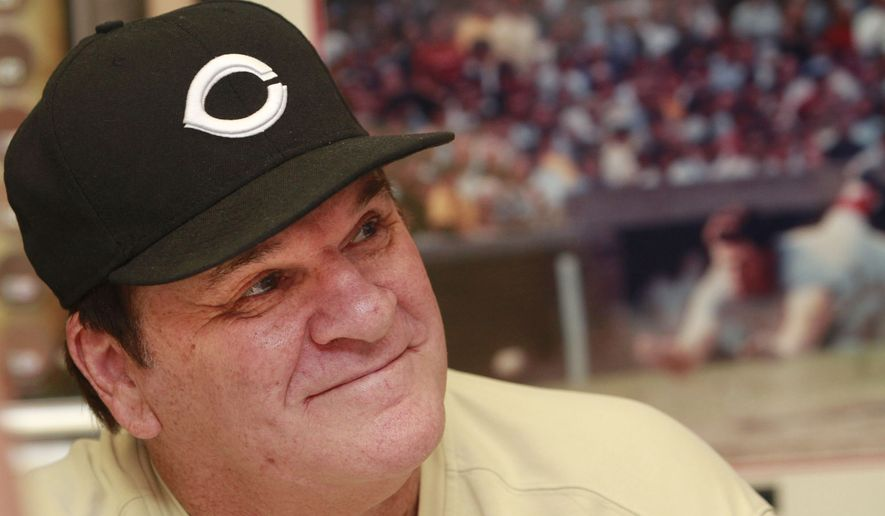 "FILE - In this July 26, 2011, file photo, former Cincinnati Reds player Pete Rose signs autographs at the Collectors Den in at a mall in Indianapolis. Rose has submitted a new request to be reinstated to baseball, according to new Commissioner Rob Manfred. After meeting with the Los Angeles Dodgers on Monday, March 16, 2015, Manfred said ""I do have a formal request from Pete.  (AP Photo/The Indianapolis Star, Charlie Nye, File)  NO SALES"