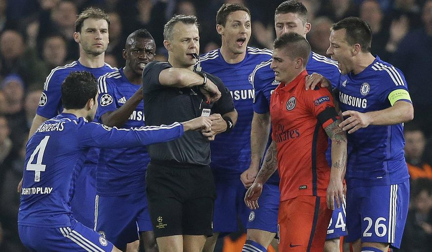 FILE - In this Wednesday, March 11, 2015 file photo Chelsea players remonstrate with referee Bjorn Kuipers just before he showed a red card to PSG's Zlatan Ibrahimovic during the Champions League round of 16 second leg soccer match between Chelsea and Paris Saint Germain at Stamford Bridge stadium in London. (AP Photo/Matt Dunham, File)