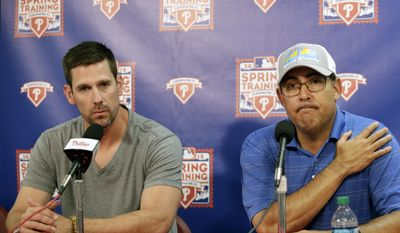Philadelphia Phillies starting pitcher Cliff Lee, left, is joined by the Phillies general manager Ruben Amaro as he speaks to members of the media about his elbow injury after the Phillies spring training baseball game in Clearwater, Fla., Monday, March 16, 2015. Lee has been placed on the 60-day disabled list by the Phillies to attempt to rehabilitate an elbow injury without surgery. The team announced Monday that an operation was recommended. (AP Photo/Kathy Willens)