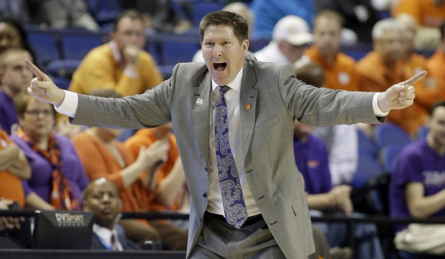 Clemson head coach Brad Brownell directs his team against Florida State during the second half of an NCAA college basketball game in the second round of the Atlantic Coast Conference tournament in Greensboro, N.C., Wednesday, March 11, 2015. (AP Photo/Bob Leverone)