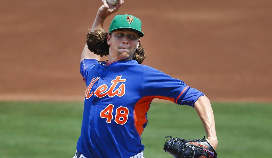 New York Mets starting pitcher Jacob deGrom (48) works in the first inning of an exhibition spring training baseball game against the Miami Marlins Tuesday, March 17, 2015, in Port St. Lucie, Fla. (AP Photo/John Bazemore)