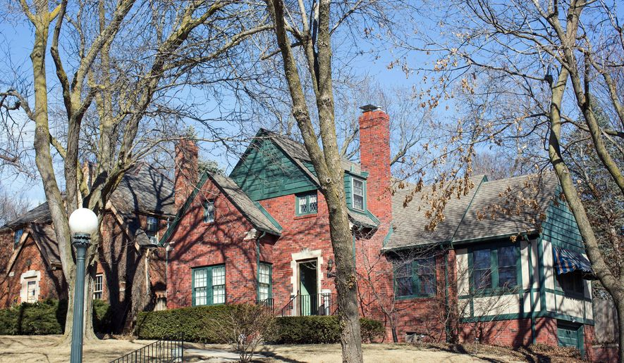 This March 2015 photo provided by home-sharing service Airbnb shows Warren Buffett's childhood home at 2501 N. 53rd Street in central Omaha, Neb. Airbnb is offering a free three-night stay at the home around the company's May 2, 2015 annual meeting as a way to promote its services. Shareholders who want to stay at the three-bedroom house must submit short essays and prove they own Berkshire stock. (AP Photo/Airbnb, Dana Damewood)