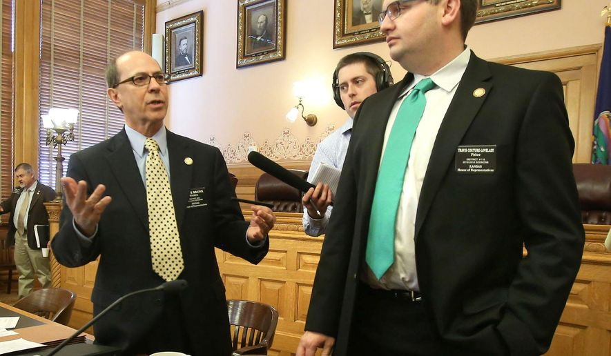 State Rep. Steve Brunk, R-Wichita, left, chairman of the House Federal and State Affairs committee,  and Travis Couture-Lovelady, R-Palco, vice-chairman of the House Federal and State Affairs committee, spoke to reporters after the committee voted overwhelmingly, Tuesday morning, March 17, 2015, in Topeka, Kan., to allow residents 21 or older to legally carry concealed firearms without a state permit. (AP Photo/The Topeka Capital-Journal, Thad Allton)