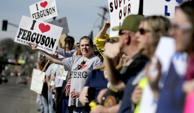 Pro-police demonstrators protest outside the Ferguson Police Department Sunday, March 15, 2015, in Ferguson, Mo. (AP Photo/Jeff Roberson)