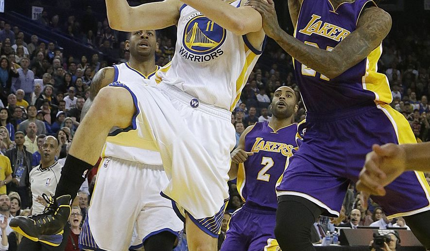 Golden State Warriors guard Klay Thompson (11) shoots against Los Angeles Lakers center Jordan Hill during the second half of an NBA basketball game in Oakland, Calif., Monday, March 16, 2015. The Warriors won 108-105. (AP Photo/Jeff Chiu)