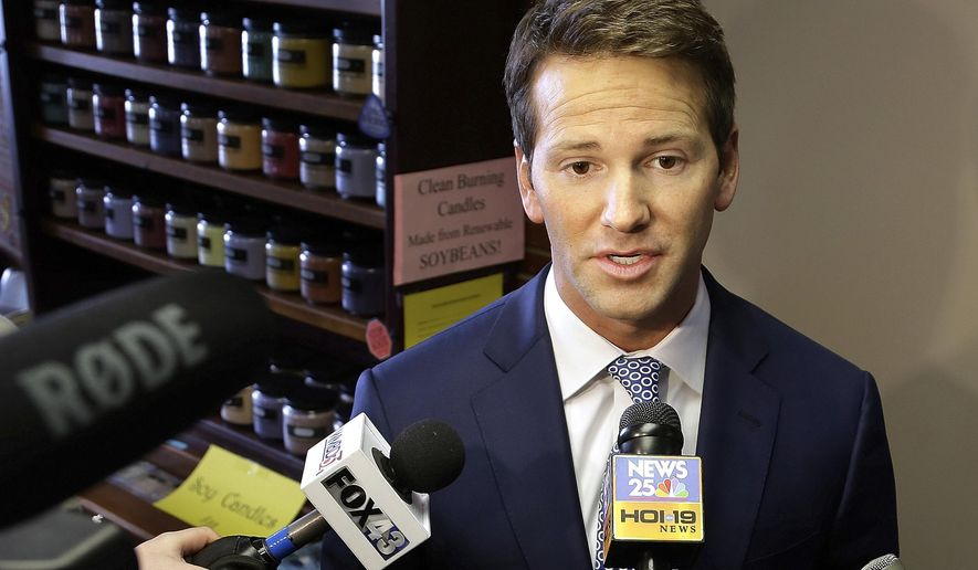 FILE - In this Feb. 6, 2015 file photo, Rep. Aaron Schock, R-Ill. speaks to reporters in Peoria, Ill. Schock announced Tuesday his resignation amid questions about spending. (AP Photo/Seth Perlman, File)