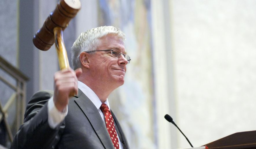 """FILE - In this Sept. 6, 2011, file photo Missouri Republican Lt. Gov. Peter Kinder gavels in the Missouri Senate in Jefferson City, Mo. Missouri's lieutenant governor is accusing Justice Department officials of """"fanning the flames of racial division,"""" as the federal agency is criticizing Ferguson police for alleged racial biases following the fatal shooting of Michael Brown, on Tuesday, March 17, 2015. (AP Photo/Kelley McCall, File)"""