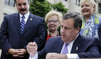 New Jersey Assemblyman Speaker Vincent Prieto, left, D-Secaucus, N.J., Sen. Loretta Weinberg, second left, D-Teaneck, N.J., and Sen. Diane B. Allen, right, R-Burlington, N.J., look on as New Jersey Gov. Chris Christie signs a bill Tuesday, May 27, 2014, in Trenton, N.J., that will allow access to birth records for people adopted in the state. The law does not kick in immediately. Birth parents of children adopted before Aug. 1, 2015 would have until the end of 2016 to request their names be removed from the birth certificates.  (AP Photo/Mel Evans)
