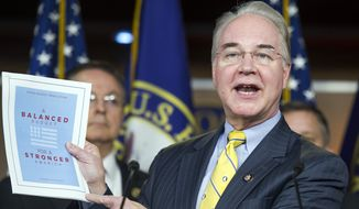 House Budget Committee Chairman Rep. Tom Price, R-Ga. holds-up a synopsis of the House Republican budget proposal as he announces the plan on Capitol Hill in Washington, Tuesday, March 17, 2015. The plan includes a boost in defense spending but cuts in the Medicaid program for the poor, food stamps and health care subsidies. (AP Photo/Cliff Owen)