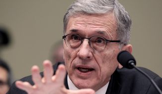 Federal Communications Commission Chairman Tom Wheeler testifies before the House Oversight and Government Reform Committee hearing on net neutrality. (AP Photo/Lauren Victoria Burke) ** FILE **