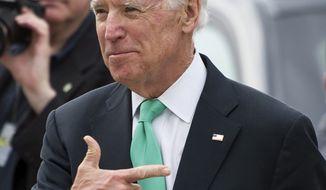 Vice President Joe Biden, wearing shamrocks in his breast pocket, departs the Capitol in Washington, Tuesday, March 17, 2015, following a Friends of Ireland luncheon in Washington. (AP Photo/Cliff Owen)