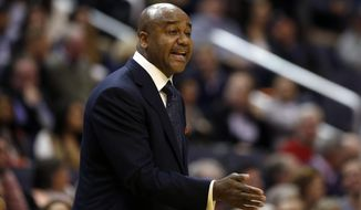 FILE - In this Jan. 19, 2015 file photo, Georgetown head coach John Thompson III directs his team during the first half of an NCAA college basketball game against Villanova, in Washington. Missing out on March Madness entirely a year ago, relegated instead to the NIT. Winning a grand total of one game in the NCAAs since 2009. Losing to a team seeded 10th or worse in each of the Hoyas' last five NCAA appearances. So even if the faces have changed, and history does not dictate what happens now, with fourth-seeded Georgetown's South Region opener against 13th-seeded Eastern Washington at Portland, Oregon. (AP Photo/Alex Brandon, File)