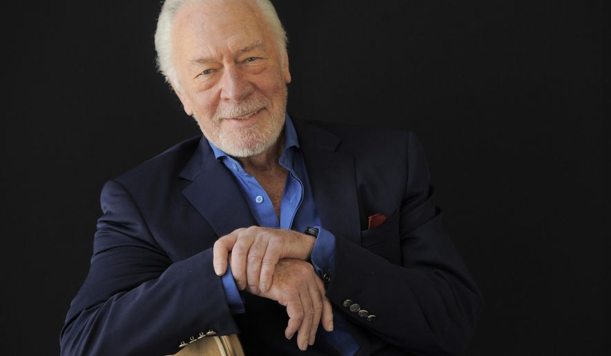 """FILE - In this July 25, 2013, file photo, Christopher Plummer, a cast member in the HBO film """"Muhammad Ali's Greatest Fight,"""" poses for a portrait at the Beverly Hilton Hotel in Beverly Hills, Calif. Plummer is among """"The Sound of Music"""" cast members celebrating the film's 50th anniversary in March 2015. The Rogers & Hammerstein classic is also facilitating another honor for the actor: the TCM Classic Film Festival's celebration of the musical will include Plummer adding his hands and feet to the collection of superstar cement prints outside Hollywood's Chinese Theatre on March 27, 2015. (Photo by Chris Pizzello/Invision/AP, File)"""