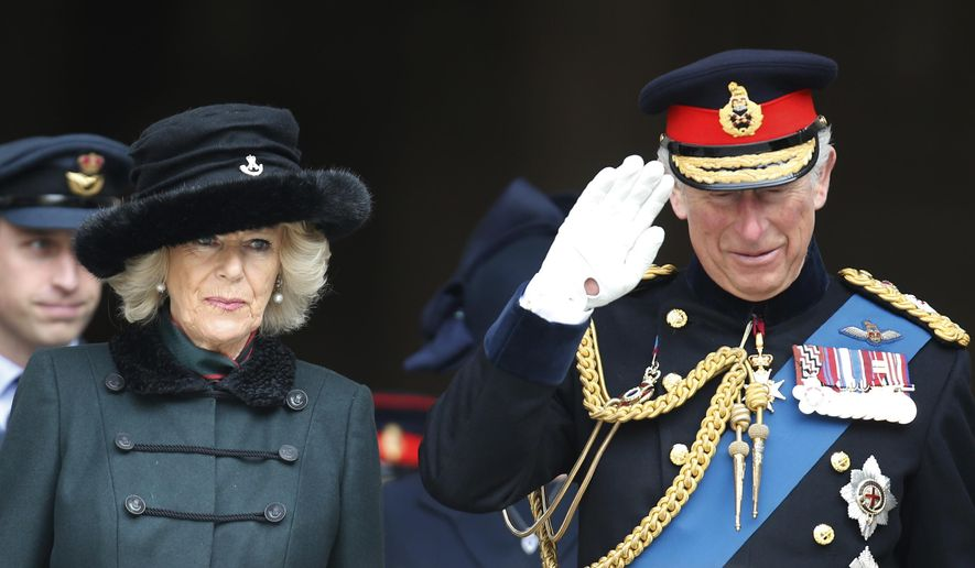 FILE - In this Friday, March 13, 2015, file photo, Britain's Prince Charles, right, and the Duchess of Cornwall leave St Paul's Cathedral, in central London, after attending a service of commemoration to pay tribute to members of the British armed forces, past and present, who served on operations in Afghanistan. Prince Charles and his wife, Camilla, are set to arrive in Washington on Tuesday, March 17, 2015, and will visit cultural and educational sites over the course of three days. (AP Photo/Lefteris Pitarakis, File)
