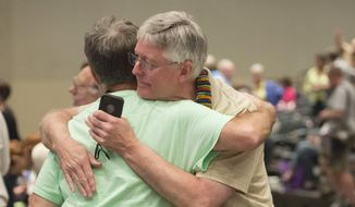 "FILE - In this June 19, 2014, file photo, Gary Lyon, left, of Leechburg, Pa., and Bill Samford, of Hawley, Pa., celebrate after a vote allowing Presbyterian pastors discretion in marrying same-sex couples at the 221st General Assembly of the Presbyterian Church at Cobo Hall, in Detroit. The Presbyterian Church (U.S.A.) approved redefining marriage in the church constitution Tuesday, March 17, 2015, to include a ""commitment between two people,"" becoming the largest Protestant group to formally recognize gay marriage as Christian and allow same-sex weddings in every congregation. (AP Photo/Detroit News, David Guralnick, File)"