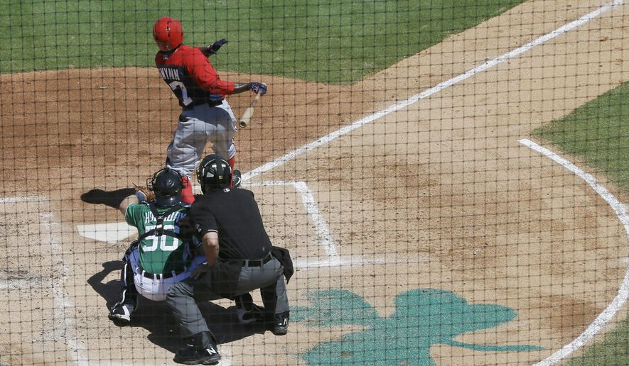 Washington Nationals center fielder Tony Gwynn hits a solo home run off Detroit Tigers pitcher Justin Verlander during the third inning of a spring training exhibition baseball game in Lakeland, Fla., Tuesday, March 17, 2015. (AP Photo/Carlos Osorio)