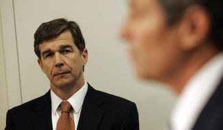 North Carolina Attorney General Roy Cooper (Associated Press) **FILE**
