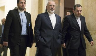 Iran's Foreign Minister Mohammad Javad Zarif, center, walks away after talks with United States Secretary of State John Kerry in Lausanne, Switzerland, Tuesday March 17, 2015. Top U.S. and Iranian diplomats returned to talks on Tuesday, trying to resolve differences blocking a deal that would curtail Iran's nuclear program and ease sanctions on the country. (AP Photo/Brian Snyder, Pool)
