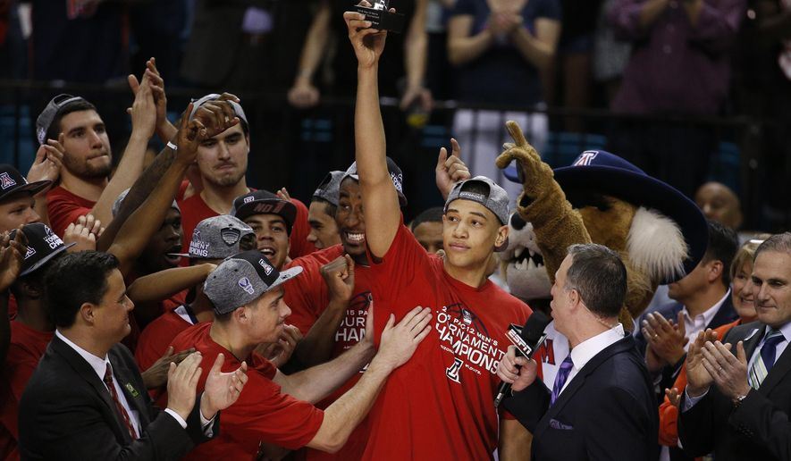 Arizona's Brandon Ashley holds up the most outstanding player of the tournament trophy after Arizona defeated Oregon in an NCAA college basketball game in the championship of the Pac-12 conference tournament Saturday, March 14, 2015, in Las Vegas. (AP Photo/John Locher)