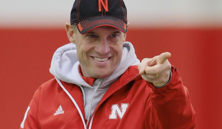 Nebraska head coach Mike Riley points during NCAA college football practice in Lincoln, Neb., Wednesday, March 18, 2015. (AP Photo/Nati Harnik)