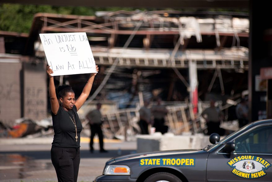 The QuikTrip convenience store in Ferguson, Mo., was a target of racial protests last summer. Now, the parent company is joining corporate efforts to spur economic opportunity in the city. (Associated Press)