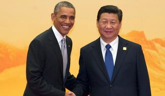 LED IN: U.S. President Barack Obama, left, shakes hands with Chinese President Xi Jinping during a welcome ceremony for the Asia-Pacific Economic Cooperation (APEC) summit at the International Convention Center in Yanqi Lake, Beijing, China Tuesday, Nov. 11, 2014. (AP Photo/Ng Han Guan) (Associated Press)