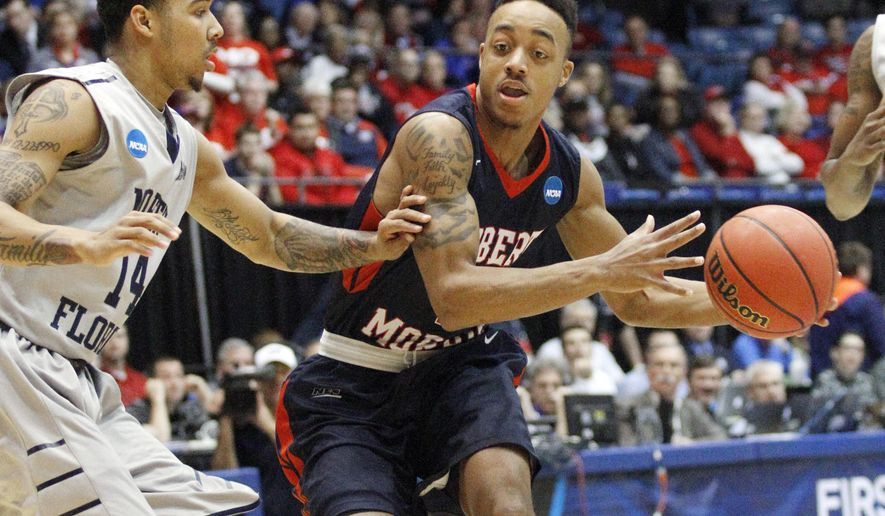 Robert Morris's Marcquise Reed, right, tries to get past North Florida's Dallas Moore (14) during the first half in the first round of the NCAA college basketball tournament, Wednesday, March 18, 2015, in Dayton, Ohio. (AP Photo/Skip Peterson)