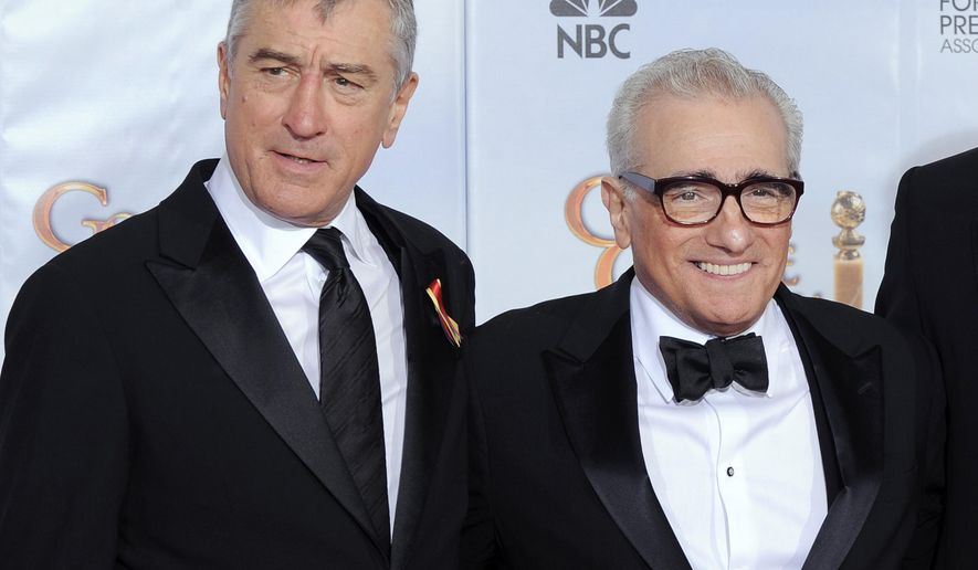 """FILE - In this Jan. 17, 2010 file photo, Robert De Niro, left, and Martin Scorsese, winner of the Cecil B. Demille Lifetime Achievement award backstage at the 67th Annual Golden Globe Awards in Beverly Hills, Calif. The cast of Martin Scorsese's """"GoodFellas"""" will reunite for the film's 25th anniversary at the Tribeca Film Festival. The festival announced Wednesday that a re-mastered version of the gangster film classic will close the 14th annual Tribeca Film Festival on April 25. Following the screening at New York's Beacon Theatre, Jon Stewart will host a conversation with Scorsese and the cast, including Robert De Niro, Joe Pesci, Lorraine Bracco, Ray Liotta and Paul Sorvino. The festival runs April 15-26. (AP Photo/Mark J. Terrill, File)"""