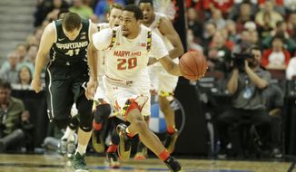 Maryland's Richaud Pack (20) heads up court against Michigan State in the first half of an NCAA college basketball game in the semifinals of the Big Ten Conference tournament in Chicago, Saturday, March 14, 2015. (AP Photo/Nam Y. Huh)