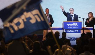 Israeli Prime Minister Benjamin Netanyahu greets supporters at the party's election headquarters in Tel Aviv. Wednesday, March 18, 2015. Netanyahu's ruling Likud Party scored a resounding victory in the country's election, final results showed Wednesday, a stunning turnaround after a tight race that had put his lengthy rule in jeopardy.(AP Photo/Dan Balilty)