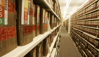 Books of birth certificates are archived in Ohio Department of Health Vital Statistics building in Columbus. An Ohio law that has kept 32 years of adoption records sealed will sunset Friday, permitting some 400,000 adoptees to ask for their original birth certificates. (Associated Press)