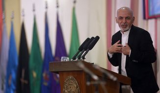 Afghan President Ashraf Ghani speaks during a graduation ceremony inspects guards of honor at a military academy, in Kabul, Afghanistan, Wednesday, March 18, 2015. (AP Photo/Massoud Hossaini)