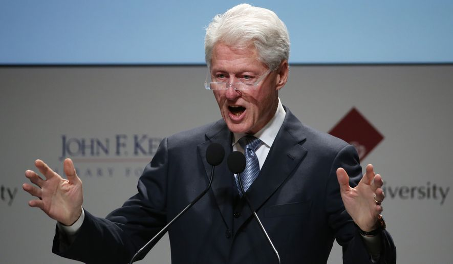 Former President of the United States Bill Clinton delivers a speech during the JFK International Symposium at Waseda University in Tokyo, Wednesday, March 18, 2015. (AP Photo/Eugene Hoshiko)