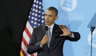 President Barack Obama speaks at The City Club of Cleveland, Wednesday, March 18, 2015, in Cleveland. Obama visited Cleveland, in the all-important presidential battleground state of Ohio, delivering a speech focusing on middle-class economics and to draw contrasts with Republicans over federal spending. (AP Photo/Tony Dejak)