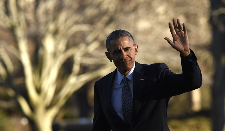President Barack Obama waves after stepping of Marine One helicopter on the South Lawn of the White House in Washington, Wednesday, March 18, 2015, after returning from a trip to Cleveland where he spoke about the importance of middle class economics to the City Club of Cleveland. (AP Photo/Susan Walsh)