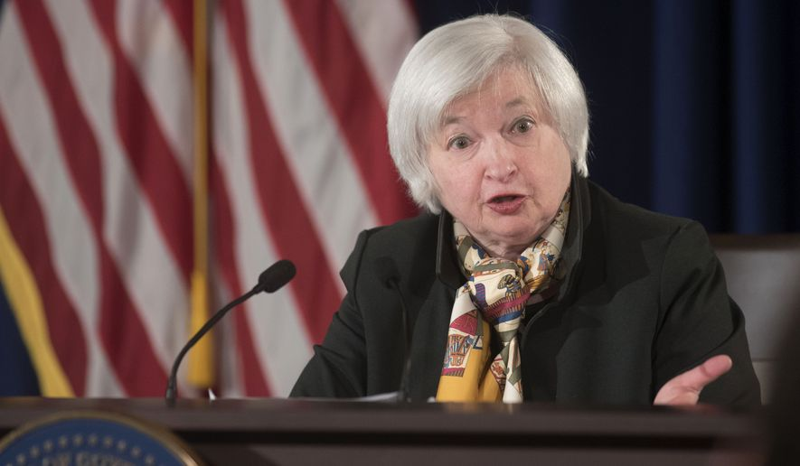 Federal Reserve Chair Janet Yellen speaks during a news conference at the end of the Federal Open Market Committee meeting in Washington,  Wednesday, March 18, 2015. Yellen said the broad pay increases usually associated with job growth may not occur anytime soon.  (AP Photo/Kevin Wolf)