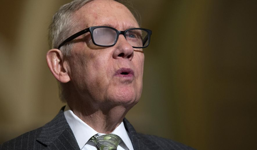 In this March 17, 2015, file photo, Senate Minority Leader Harry Reid of Nev. speaks to reporters on Capitol Hill in Washington. (AP Photo/Molly Riley, File)