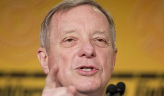 "In this March 9, 2015, file photo, Senate Minority Whip Richard Durbin of Ill. speaks in Washington. Durbin is accusing Republican of putting Loretta Lynch, President Barack Obama's attorney general nominee ""in the back of the bus."" (AP Photo/Pablo Martinez Monsivais, File)"