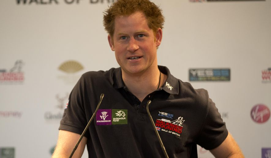Britain's Prince Harry speaks during the launch of the Walking with the Wounded, Walk of Britain charity event, in London, Wednesday March 18, 2015. Five wounded veterans will walk 1000 miles through mainland Britain, starting in Scotland on August 22 and ending in London on Oct. 31. (AP Photo/Alastair Grant, Pool)