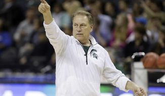 Michigan State head coach Tom Izzo directs his team during practice at the NCAA college basketball tournament in Charlotte, N.C., Thursday, March 19, 2015. Michigan State plays Georgia in the second round on Friday. (AP Photo/Gerald Herbert)