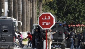 Rescue workers evacuate children, left, and adults after gunmen opened fire at the Bardo museum in Tunisia's capital, Wednesday, March 18, 2015 in Tunis. Authorities say scores of people are dead after an attack on a major museum in the Tunisian capital, and some of the gunmen may have escaped. (AP Photo/Ali Ben Salah)