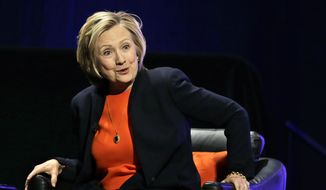 Former Secretary of State Hillary Rodham Clinton smiles as she answers a question after addressing around 3,000 summer camp and out of school time professionals at the American Camp Association and Tri State CAMP conference Thursday, March 19, 2015, in Atlantic City, N.J. (AP Photo/Mel Evans)