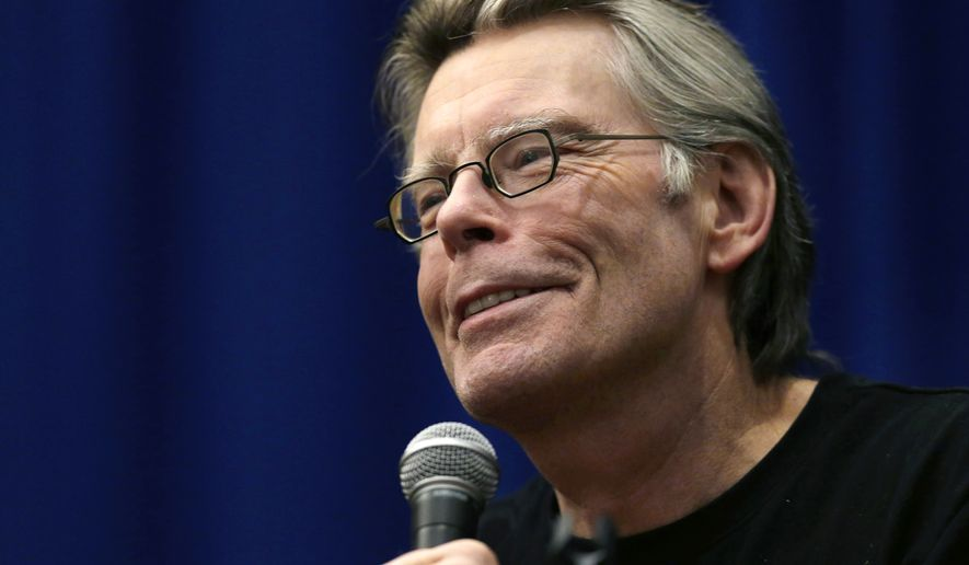 In this Dec. 7, 2012, file photo, novelist Stephen King speaks to creative writing students at the University of Massachusetts-Lowell in Lowell, Mass. King says he still lives in Maine, and he insists that Gov. Paul LePage's claim that he has moved from the state is inaccurate. (AP Photo/Elise Amendola, File)