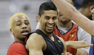 Maryland's Richaud Pack, left, picks up Varun Ram during practice at the NCAA college basketball tournament in Columbus, Ohio, Thursday, March 19, 2015. Maryland plays Valparaiso in the second round on Friday. (AP Photo/Tony Dejak)